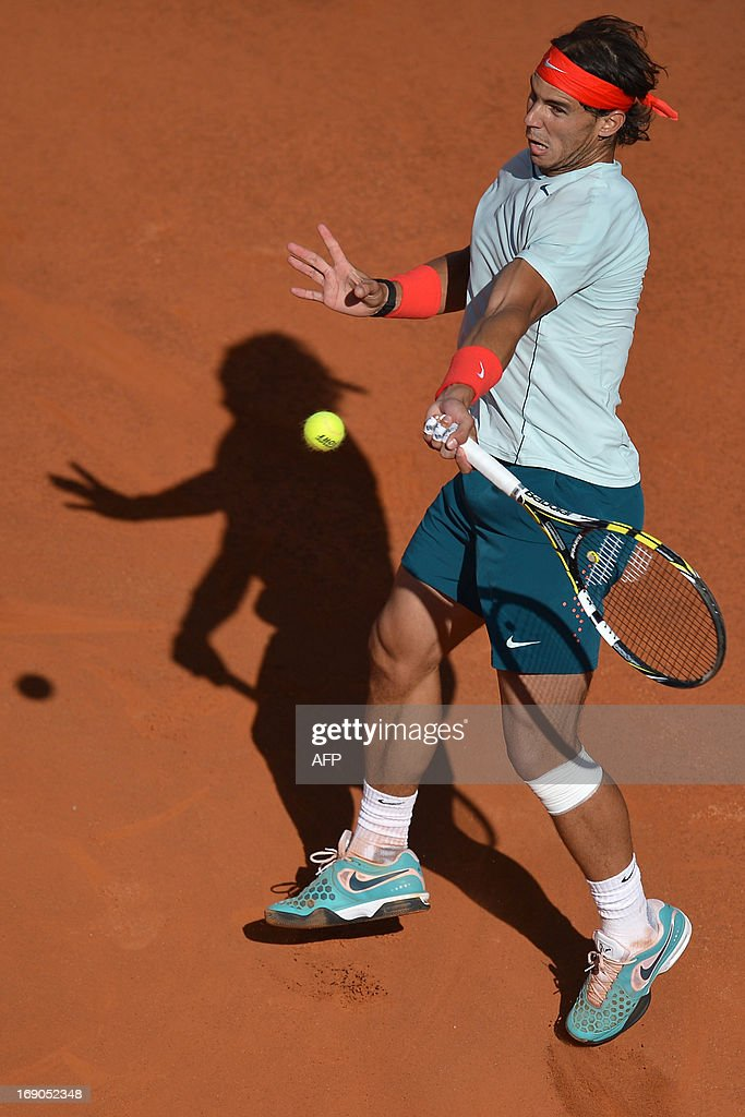 Spain's Rafael Nadal returns a ball to Switzerland's Roger Federer during the final of the ATP Rome Masters on May 19, 2013.