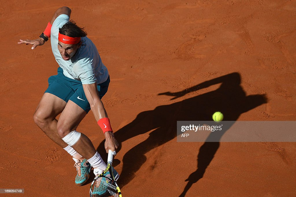 Spain's Rafael Nadal returns a ball to Switzerland's Roger Federer during the final of the ATP Rome Masters on May 19, 2013. Nadal crushes Federer 6-1, 6-3 to win seventh Rome title.