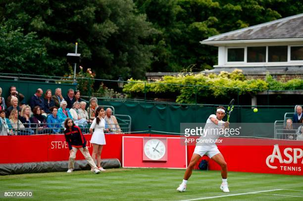 Spain's Rafael Nadal returns against Czech Republic's Tomas Berdych during his men's singles match at The Hurlingham Tennis Classic tournament at the...
