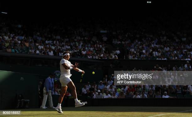 Spain's Rafael Nadal returns against US player Donald Young during their men's singles second round match on the third day of the 2017 Wimbledon...
