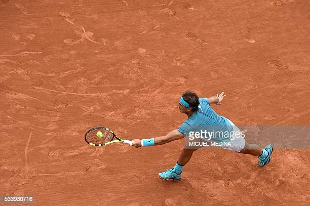 Spain's Rafael Nadal returns the ball to Australia's Samuel Groth during their men's first round match at the Roland Garros 2016 French Tennis Open...