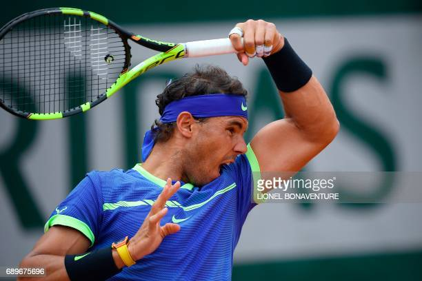 Spain's Rafael Nadal returns the ball to France's Benoit Paire during their tennis match at the Roland Garros 2017 French Open on May 29 2017 in...
