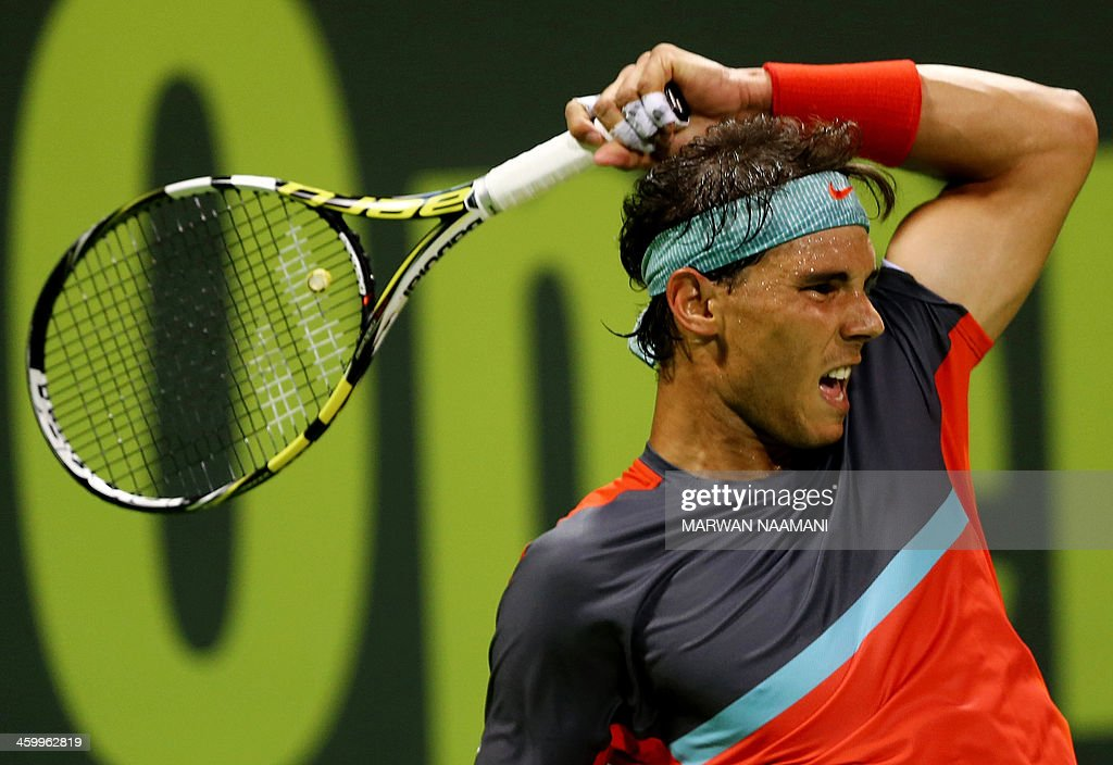 Spain's Rafael Nadal returns the ball to Germany's Tobias Kamke during their tennis match in Qatar's ExxonMobil Open in Doha on January 01 2014 AFP...