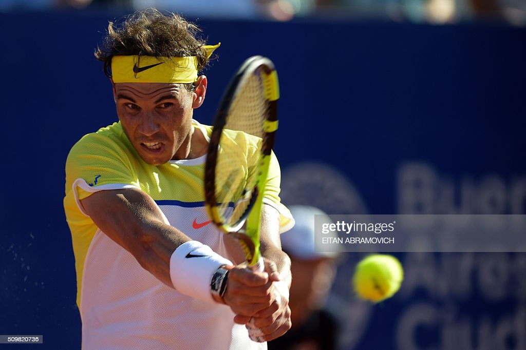 Spain's Rafael Nadal returns the ball to Italy's Paolo Lorenzi (out of frame) during their ATP Argentina Open quarterfinal tennis match in Buenos Aires, Argentina, on February 12, 2016. AFP PHOTO/EITAN ABRAMOVICH / AFP / EITAN ABRAMOVICH
