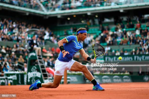 TOPSHOT Spain's Rafael Nadal returns the ball to Spain's Pablo Carreno Busta during their tennis match at the Roland Garros 2017 French Open on June...