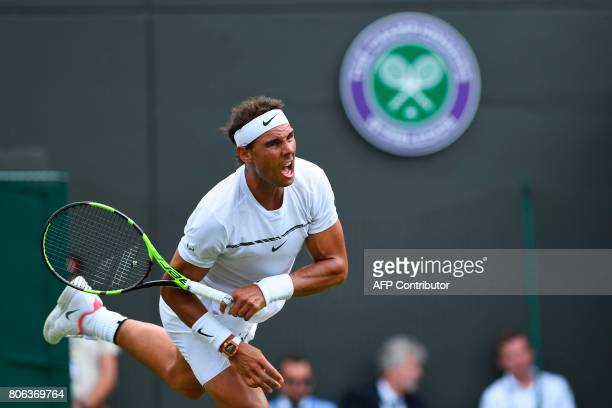 Spain's Rafael Nadal serves against Australia's John Millman during their men's singles first round match on the first day of the 2017 Wimbledon...