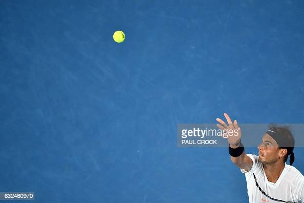 TOPSHOT Spain's Rafael Nadal serves against France's Gael Monfils during their men's singles fourth round match on day eight of the Australian Open...