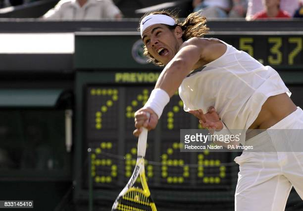 Spain's Rafael Nadal serves against Switzerland's Roger Federer in the fifth and final set during The All England Lawn Tennis Championship at...