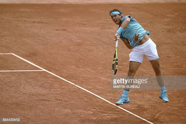 TOPSHOT Spain's Rafael Nadal serves the ball to Argentina's Facundo Bagnis during their men's second round match at the Roland Garros 2016 French...