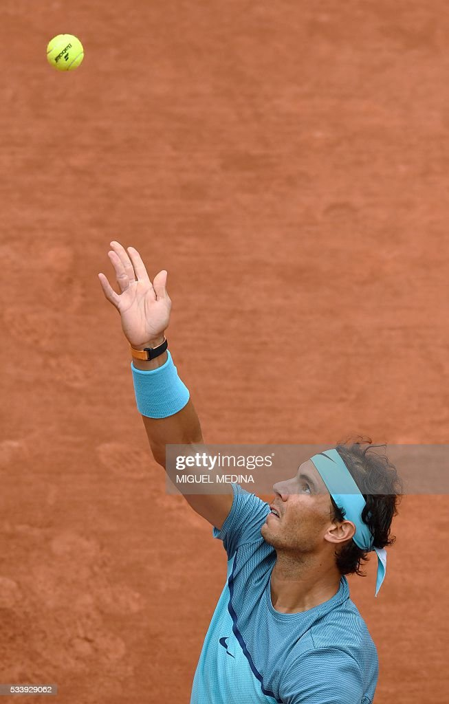 Spain's Rafael Nadal serves the ball to Australia's Samuel Groth during their men's first round match at the Roland Garros 2016 French Tennis Open in Paris on May 24, 2016. / AFP / MIGUEL