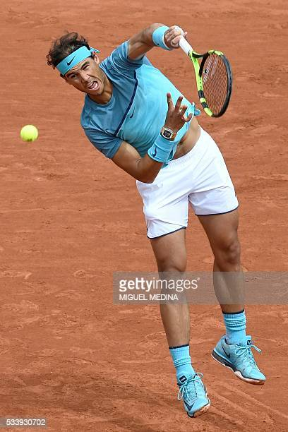 Spain's Rafael Nadal serves the ball to Australia's Samuel Groth during their men's first round match at the Roland Garros 2016 French Tennis Open in...