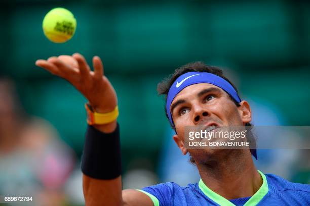 Spain's Rafael Nadal serves to France's Benoit Paire during their tennis match at the Roland Garros 2017 French Open on May 29 2017 in Paris / AFP...