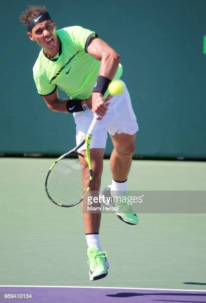 Spain's Rafael Nadal serves to France's Nicolas Mahut in the fourth round of the Miami Open at Crandon Park Tennis Center in Key Biscayne Fla on...