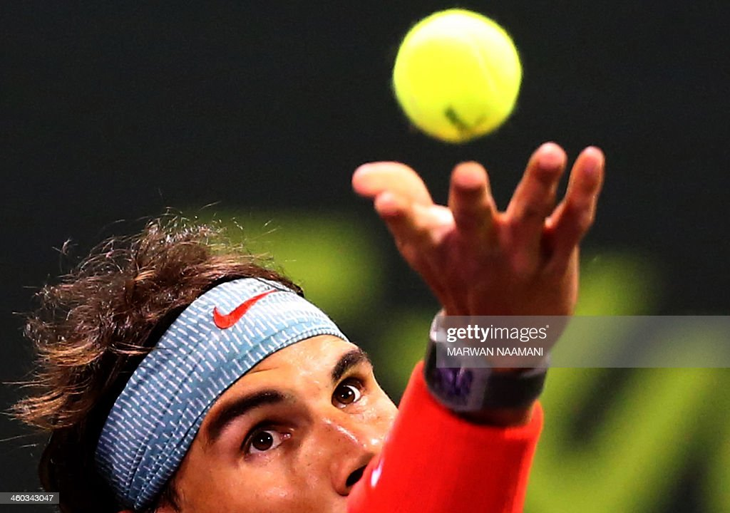 Spain's Rafael Nadal serves to Germany's Peter Gojowczyk during their semi final tennis match in Qatar's ExxonMobil Open in Doha on January 3 2014...