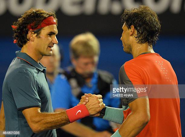 Spain's Rafael Nadal shakes hands with Switzerland's Roger Federer after his victory during their men's singles semifinal match on day 12 of the 2014...