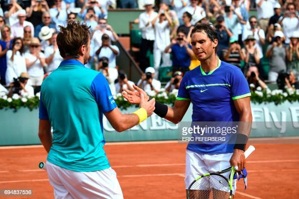 Spain's Rafael Nadal shakes hands with Switzerland's Stanislas Wawrinka after winning the men's final tennis match at the Roland Garros 2017 French...