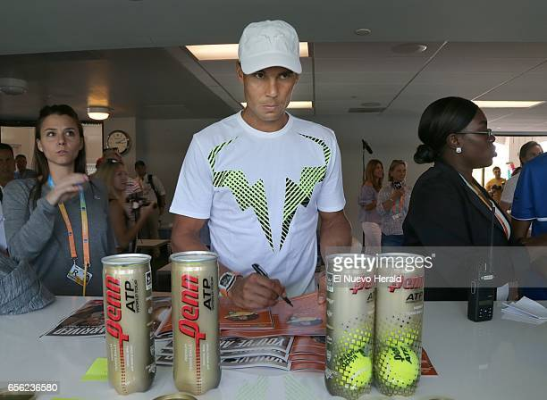 Spain's Rafael Nadal signs autographs after a a set of interviews ahead of the Miami Open at Crandon Park Tennis Center in Key Biscayne Fla on...