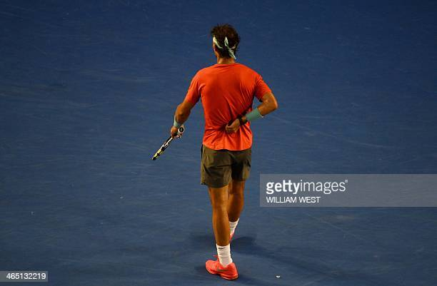Spain's Rafael Nadal touches his back before he seeks medical treatment during his men's singles final against Switzerland's Stanislas Wawrinka on...