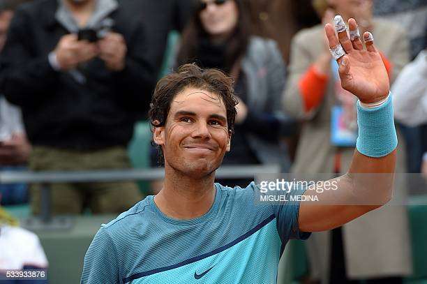 Spain's Rafael Nadal waves to the crowd after winning the men's first round match against Australia's Samuel Groth at the Roland Garros 2016 French...