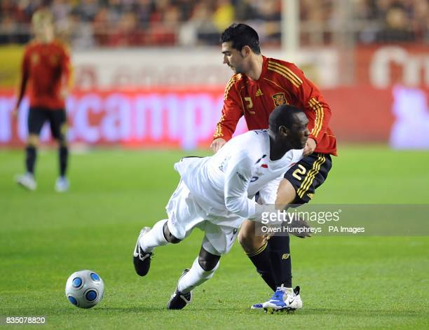 Spain's Raul Albiol and England's Emile Heskey in action