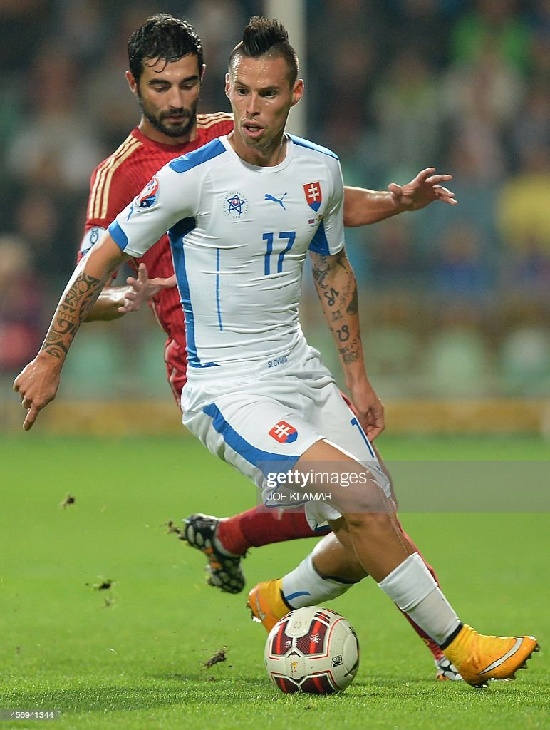 Spain's Raul Albiol and Slovakia's Marek Hamsik fight for a ball during Euro 2016 qualifing football match between Slovakia and Spain in northern...