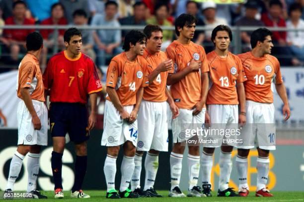 Spain's Raul infiltrates the Paraguayan defensive wall of Jorge Campos Diego Gavilan Carlos Gamarra Roque Santa Cruz Carlos Paredes and Roberto Acuna