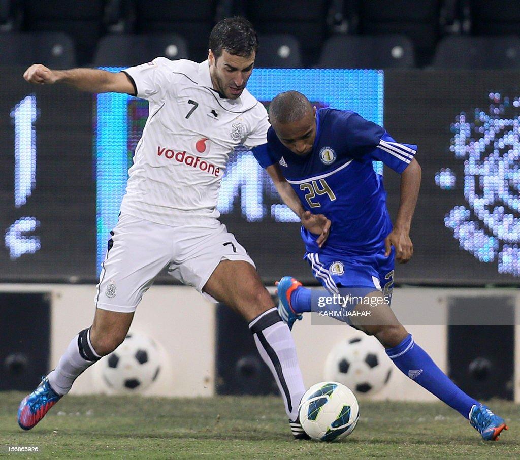 Spain's Raul (L) of Qatar's Al-Sadd club fights for possession against Mohammad Jumaa of Al-Khor during their Qatar Stars League football match in Doha, on November 23, 2012. Al-Sadd won 2-1. AFP PHOTO/KARIM JAAFAR/ AL-WATAN DOHA== QATAR OUT ==