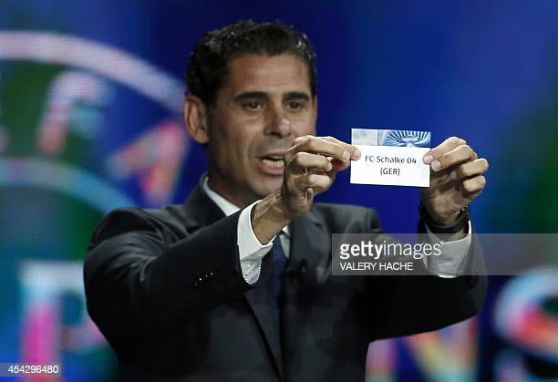 Spain's retired player Fernando Hierro presents the name FC Schalke 04 during the draw for the 2014/2015 European Champions League group stages on...
