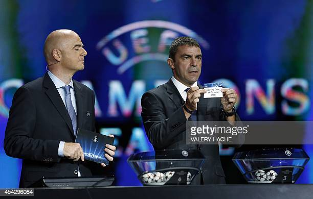 Spain's retired player Manuel Sanchis Martinez presents the name Sporting Clube de Portugal next to UEFA general secretary Gianni Infantino during...
