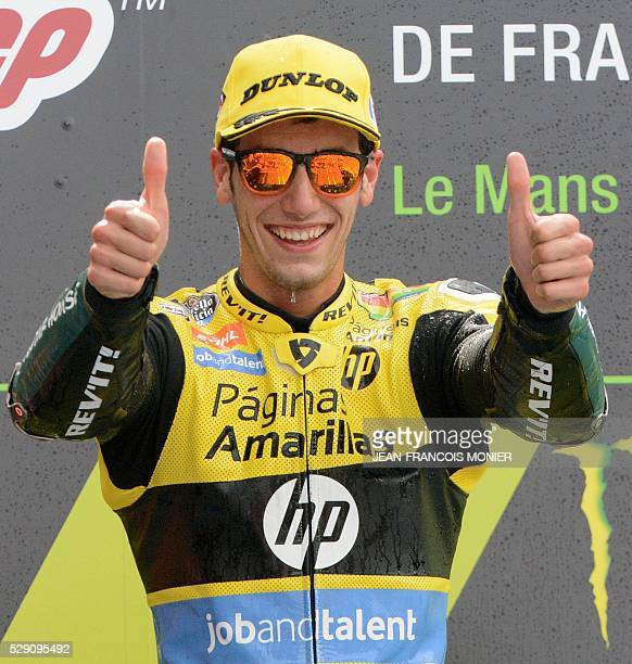 Spain's rider Alex Rins celebrates on the podium after winning during the Moto2 race of the French moto Grand Prix on May 8 2016 in Le Mans...