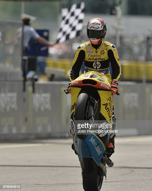 Spain's rider Alex Rins reacts after winning on his Kalex Paginnas Amarillas HP40 N��40 during the Moto2 race of the French moto Grand Prix on May 8...