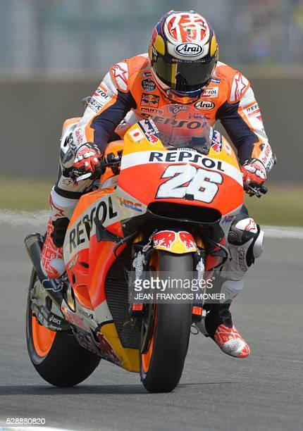 Spain's rider Dani Pedrosa competes on his Repsol Honda Team's N26 during the qualifying cession of the MotoGP ahead of the French motorcycling Grand...