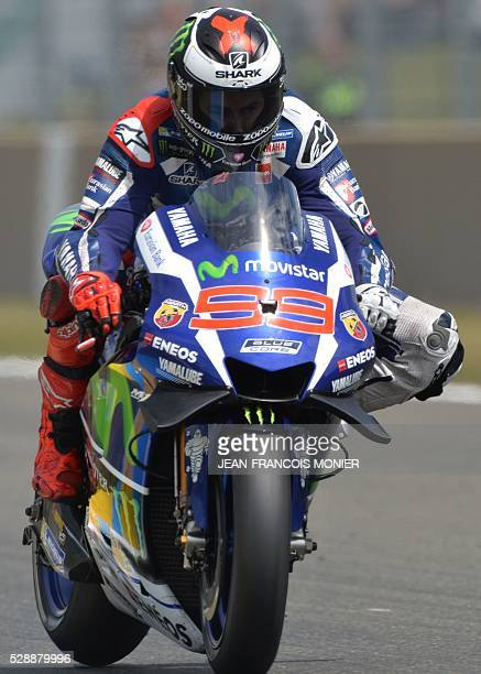 Spain's rider Jorge Lorenzo competes on his Movistar Yamaha MOTOGP N99 and clocked the Pole position during the qualifying cession of the MotoGP...