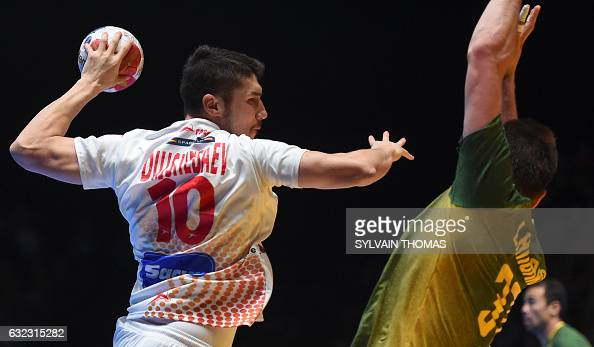 TOPSHOT Spain's right back Alex Dujshebaev shoots on goal during the 25th IHF Men's World Championship 2017 eighth final handball match Brazil vs...