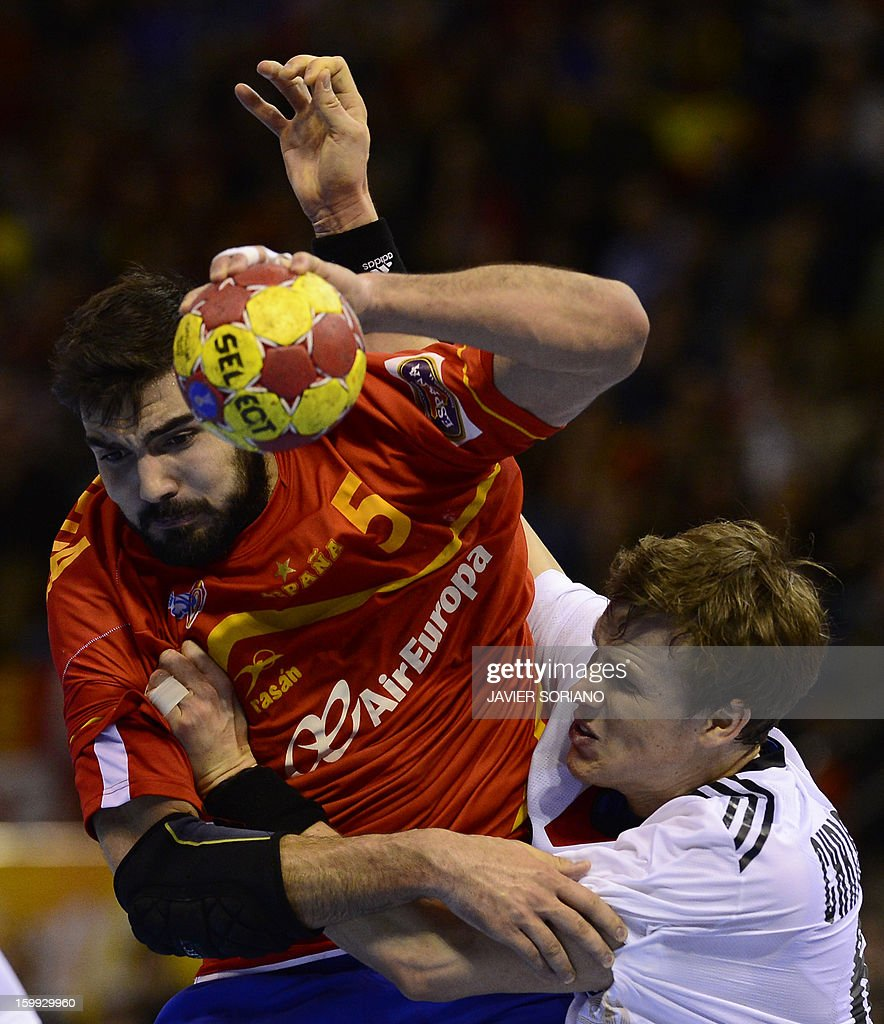 Spain's right back Jorge Maqueda vies with Germany's left back SvenSoeren Christophersen during the 23rd Men's Handball World Championships...