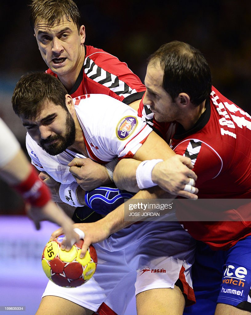 Spain's right back Jorge Maqueda (L) vies with Serbia's left back Momir Ilic and Serbia's pivot Alem Toskic (R) during the 23rd Men's Handball World Championships round of 16 match Serbia vs Spain at the Pabellon Principe Felipe in Zaragoza on January 21, 2013.