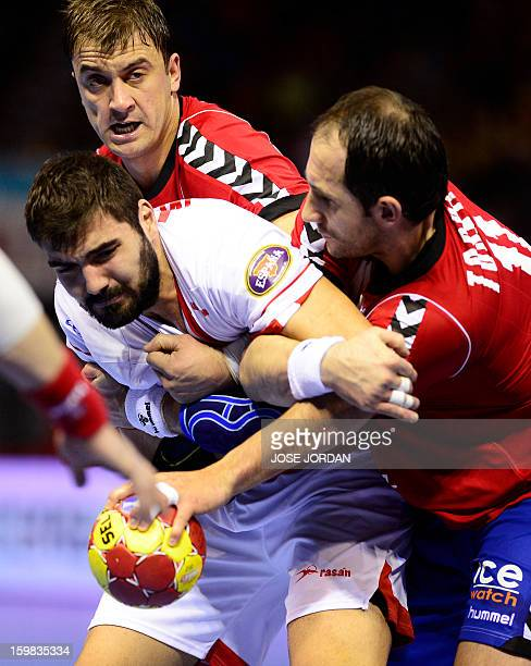 Spain's right back Jorge Maqueda vies with Serbia's left back Momir Ilic and Serbia's pivot Alem Toskic during the 23rd Men's Handball World...