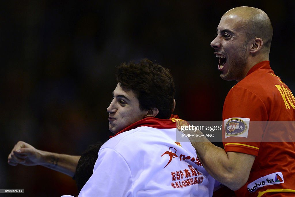 Spain's right wing Albert Rocas celebrates with teammates their victory at the end of the 23rd Men's Handball World Championships quarterfinal match...
