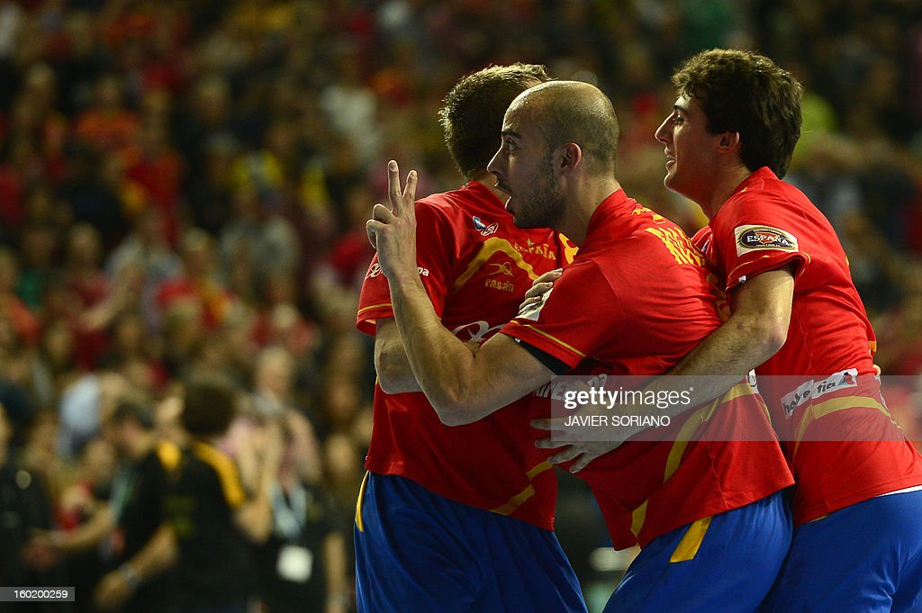 Spain's right wing Albert Rocas (L) gestures as he celebrates with teammates their victory at the end of the 23rd Men's Handball World Championships final match Spain vs Denmark at the Palau Sant Jordi in Barcelona on January 27, 2013. Spain won 35-19.