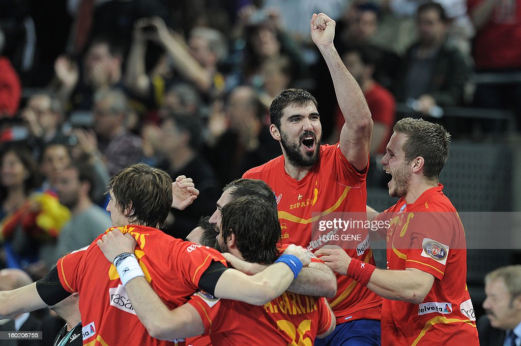 Spain's right wing Victor Tomas (R) and Spain's right back Jorge Maqueda (2ndR) celebrate with teammates their victory at the end of the 23rd Men's Handball World Championships final match Spain vs Denmark at the Palau Sant Jordi in Barcelona on January 27, 2013. Spain won 35-19.