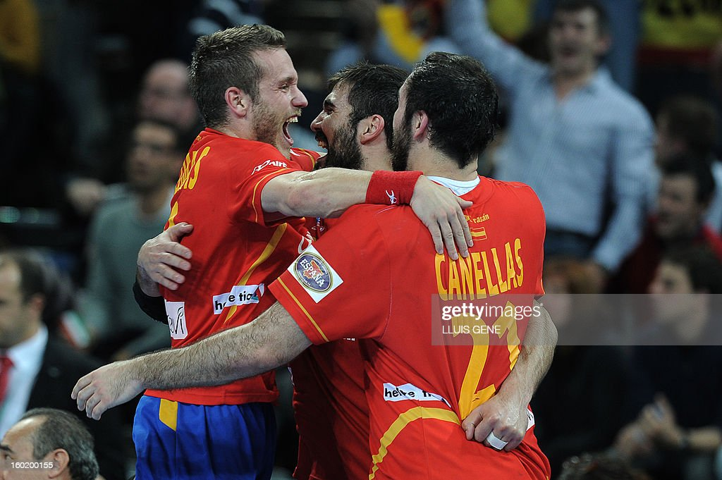 Spain's right wing Victor Tomas (L) celebrates with teammates their victory at the end of the 23rd Men's Handball World Championships final match Spain vs Denmark at the Palau Sant Jordi in Barcelona on January 27, 2013. Spain won 35-19.