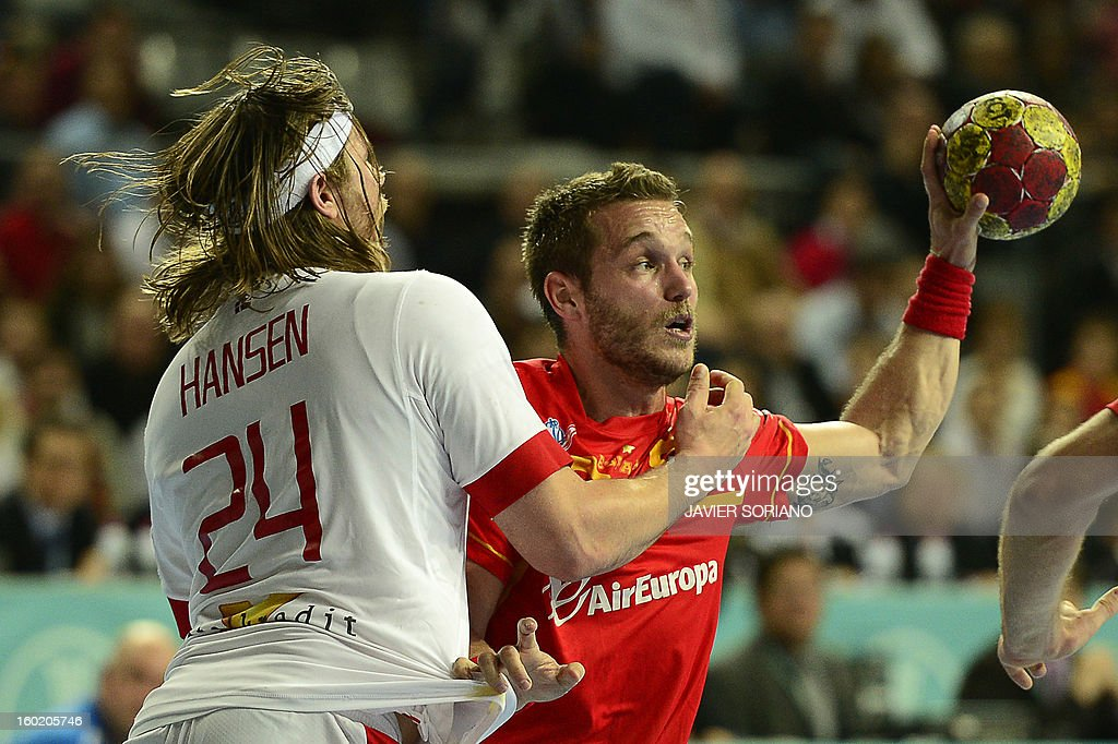 Spain's right wing Victor Tomas (R) vies with Denmark's left back Mikkel Hansen during the 23rd Men's Handball World Championships final match Spain vs Denmark at the Palau Sant Jordi in Barcelona on January 27, 2013.
