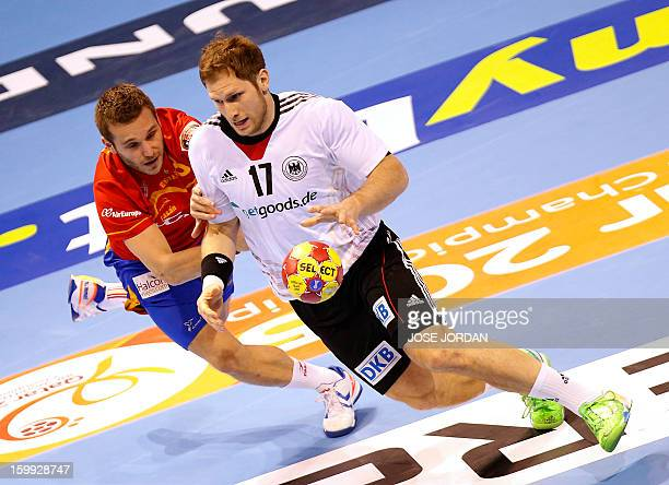 Spain's right wing Victor Tomas vies with Germany's right wing Steffen Weinhold during the 23rd Men's Handball World Championships quarterfinal match...