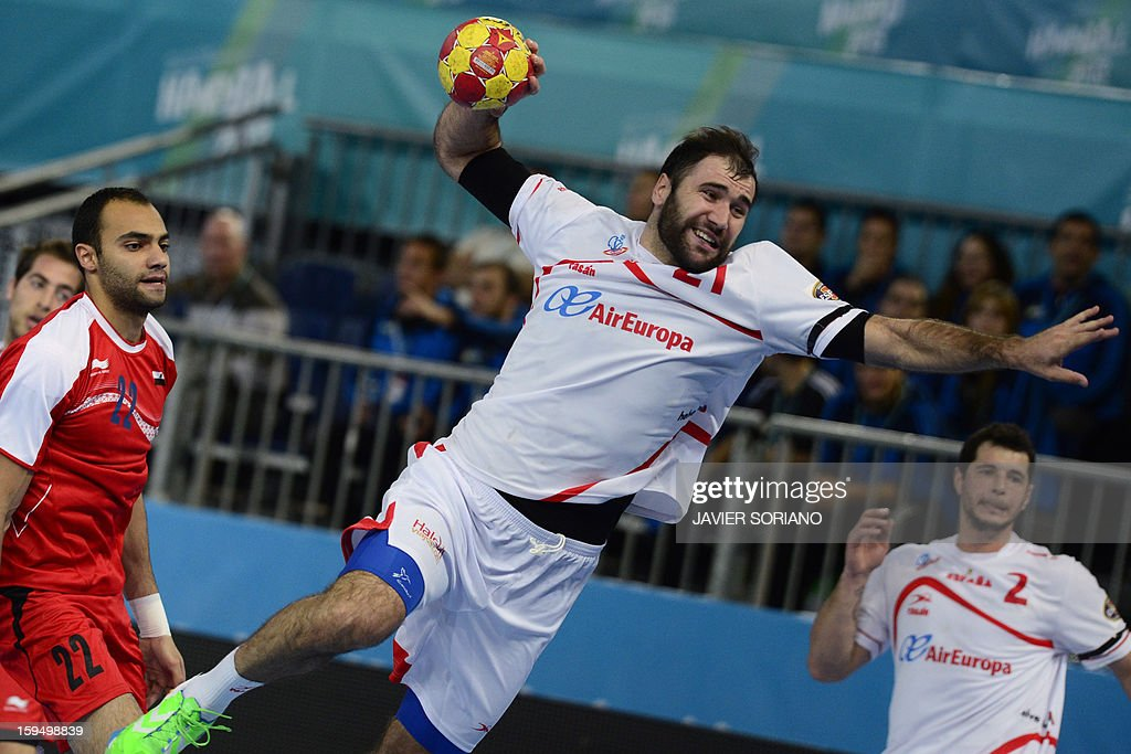 Spain's rightback Jorge Maqueda (R) shoots past to Egypt's leftback Omar Gamal (L) during the 23rd Men's Handball World Championships preliminary round Group D match Egypt vs Spain at the Caja Magica in Madrid on January 14, 2013.