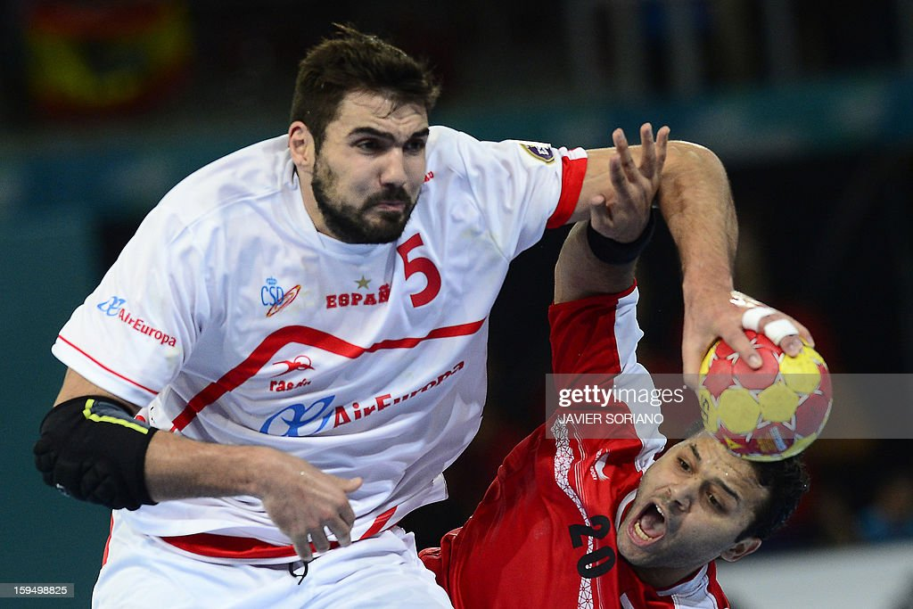 Spain's rightback Jorge Maqueda (L) vies with Egypt's centreback Mohamed Alaa (R) during the 23rd Men's Handball World Championships preliminary round Group D match Egypt vs Spain at the Caja Magica in Madrid on January 14, 2013.