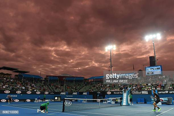 TOPSHOT Spain's Roberto Bautista Agut plays a return during his men's singles match against Croatia's Marin Cilic on day five of the 2016 Australian...