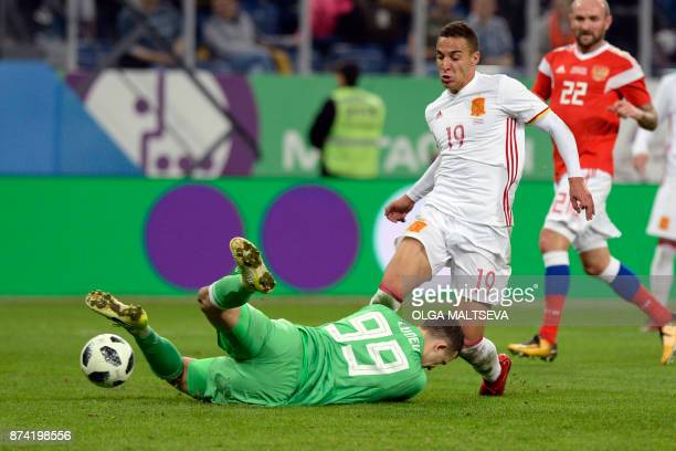 TOPSHOT Spain's Rodrigo in action against Russia's goalkeeper Andrey Lunev during an international friendly football match between Russia and Spain...