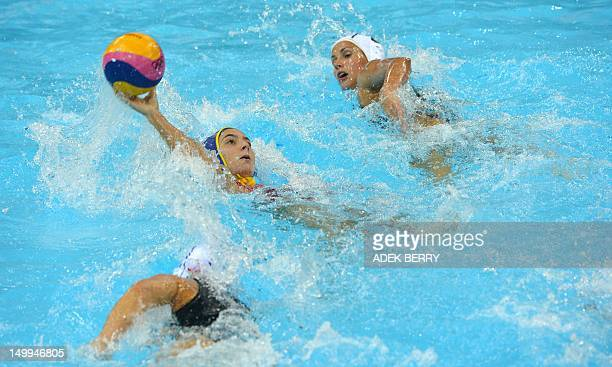Spain's Roser Tarrago Aymerich holds the ball during the women's water polo semifinal match Hungary vs Spain at the London 2012 Olympic Games in...