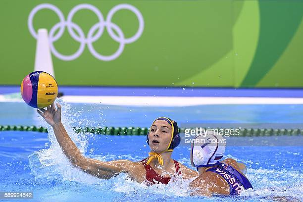 Spain's Roser Tarrago Aymerich vies with Russia's Ekaterina Lisunova during their Rio 2016 Olympic Games water polo quarterfinal game at the Olympic...