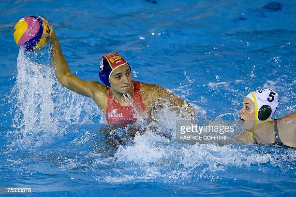 Spain's Roser Tarrago fires a shot next to Australia's Isabelle Bishop during their gold medal final match between Australia and Spain at the FINA...